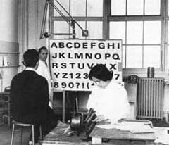 In the D & P studio: Ladislas Mandel (standing) draws the expanded version, being examined by Adrian Frutiger (seated). Lucette Girard is cutting preparatory letters